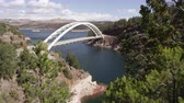 overlooking : Slow pan from right to left of Cart Creek Bridge at Flaming Gorge in Utah. Stock Footage