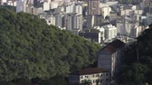 game : Tilting footage of hills and houses of Rio de Janeiro, including a view of Maracanã stadium. Filmed in Brazil. Stock Footage