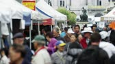 life is good : A close up, slowmotion shot of people walking through an open market in San Francisco,san francisco