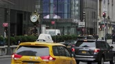 district : Manhattan, New York - March, 2015: Slow motion view of a busy street with people and vehicles in downtown Manhattan.
