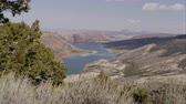 kordé : Dolly shot overlooking Flaming Gorge in the distance, in Utah. Stock mozgókép