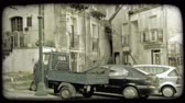 erkély : Shot of cars parked outside of some appartment buildings in Italy. Vintage stylized video clip.