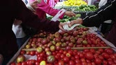 life is good : A slow pan of people buying fresh tomatoes at an open market in San Francisco,san francisco
