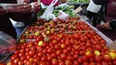 saláta : A slow pan of people buying fresh tomatoes at an open market in San Francisco,san francisco