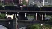 train trestle : Panning left over the entire bridge as a train passes over. Stock Footage