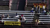 arquibancadas : Parents and other spectators at a school track and field event sitting in the stands. Vídeos