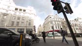 city : A busy street with crowded sidewalks and traffic at Oxford street in London, England. Filmed on October 7, 2011.