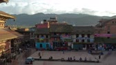 Time-lapse of dusk at Taumadhi square in Bhaktapur, Nepal. Bhairavnath temple is seen, as well as pedestrians walking through the plaza. Panning shot. Stok Video