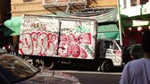 дорожный знак : Static view of delivery truck covered in graffiti on the streets of San Francisco