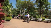 bisiklete binme : Cambodian cyclo driver (bicycle taxi) passes near Cambodian national museum in Southeast Asia