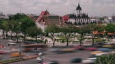 thai : Time Lapse wide shot of daytime traffic passing in front of palace in Bangkok, Thailand; polarized clouds move past Stock Footage