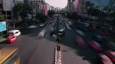 thai : Time Lapse view of two opposing lanes of traffic on a two lane street in Asian city; traffic stops and starts at intervals with traffic lights Stock Footage