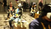 электроника : A room full of gamers wearing VR virtual reality gear made by Sony,  Oculus Rift and other manufacturers  One of a series of gaming industry and virtual reality technology clips From the virtual reality gaming technology