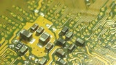 技術 : Macro Camera Dolly diagonally down computer circuit board, then return to 1st position. Shot with special macro lenses, this shot demonstrates a dynamic view of the developments in technology.