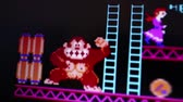 personagem : Medium Macro of Donkey Kong gorilla character rolling barrels while damsel pleads for help, as seen at near-pixel level during a motion game play analysis. Released in 1981, Donkey Kong was an important milestone in the videogame industry.