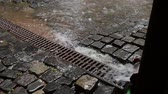 eave : Because of a heavy summer storm, abundence of rain water flows through the drain pipe. Sound included. Stock Footage