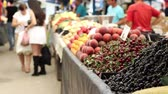 big apple : Cherries, peaches, natural fruits and vegetables at the marketplece.