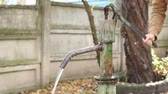 рычаг : Person using a mechanical pump for suction fresh water. Hand pumps are manually operated pumps Стоковые видеозаписи
