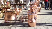 colecionável : Boilers and copper pots, handmaded, of various sizes sparkle in the sunlight.