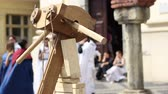 atirador : A big medieval crossbow. A crossbow is a type of weapon, based on the bow, consisting of a horizontal bow-like assembly mounted on a stock, that shoots projectiles called bolts or quarrels. The medieval crossbow was called by many names, most of which der