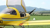 wing : With the hood open on airplane a pilot is waiting patiently to take off.