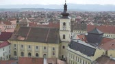 roof : Top view of the Hermanstadt catholic church. Sibiu (German: Hermannstadt, Transylvanian Saxon dialect: Härmeschtat, Hungarian: Nagyszeben is a city in Transylvania, Romania),