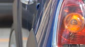 taillight : Pan shot to a car left rear light signaling. Stock Footage