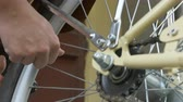 pierce : Man is unscrewing the bicycle tyre cap preparing it for air inflating.