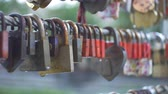 View of some love locks on a bridge standing in rain. Stock Footage