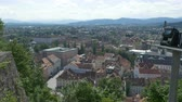 View of Slovenian capital city, with greenhills and forest surrounding it.