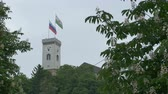 Tower of Ljubljana Castle on cloudy day.