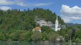 View of church on the shore of Lake Bled, in summer day.