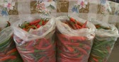 Plastic bags with chili at local market. 動画素材