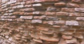 グリット : View of old water gnawed red brick wall of a building.