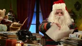 roliço : Santa Claus reading children gift letters for Christmas