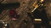 enology : Red wine poured into a rustic wooden table, top view: wine tasting and winemaking concept