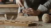furnished : Professional skilled carpenter working in the workshop and carving wood with a gouge Stock Footage