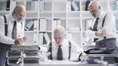 bureaucracy : Corporate business executive and his multiple personalities with different roles working together in the office: he is the boss and the stressed employee Stock Footage