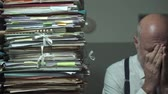 karışıklık : Stressed depressed businessman with lots of paperwork, business management and deadlines concept Stok Video