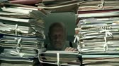 agobiado : Office clerk working behind a wall of paperwork: bureaucracy concept