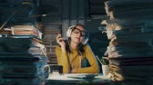 indifferent : Happy cheerful secretary wearing headphones and listening to music in the office instead of working