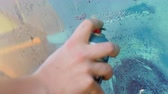 painting : Writer hand painting with spray can