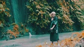 ушлый : Beautiful fashion girl posing in tropical rain forest jungle near the waterfall. Portrait of stylish hipster female outdoor