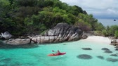 zumbido : Aerial drone view of man kayaking in crystal clear lagoon sea water during summer day near Koh Kra island in Thailand. Travel tropical island holiday concept