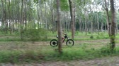 e sport : Drone view of woman on electric bicycle in the forest. Attractive woman riding her e-bike in the forest
