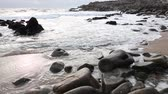 brittany : Winter waves on stones of granite coastline for tourism refreshing Stock Footage