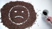 tornar : Sad smiley made of coffee beans becoming happy