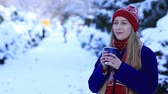 cobalt blue : Smiling young woman drinking coffee in cold winter