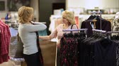shopping bag sale : Woman selecting apparel while shopping for clothes Stock Footage