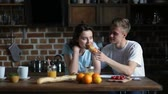 romance : Couple eating breakfast in the morning in kitchen Stock Footage